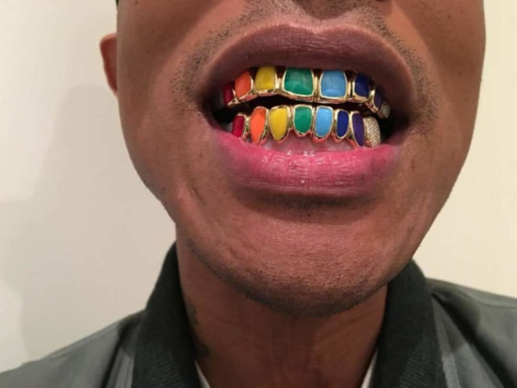 Pharrel William - rainbow grillz